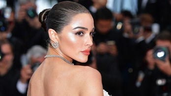 Olivia Culpo displays her toned figure in white swimsuit while on vacation: 'Bikini spam'