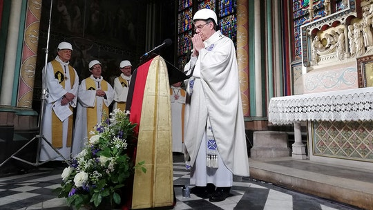 Archbishop dons hard-hat to hold first Mass in Notre Dame since devastating fire