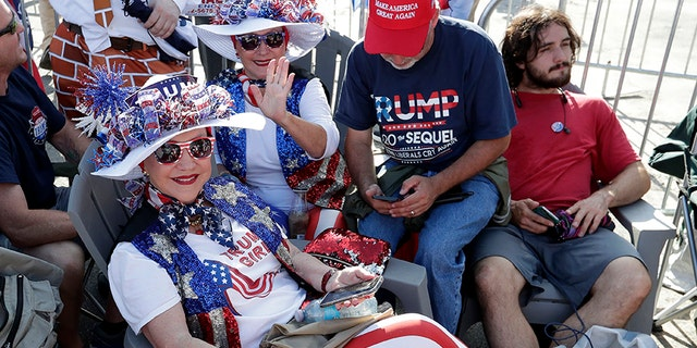 Hats and other merchandise were flying off the racks Tuesday afternoon in Orlando, ahead of Trump's rally. (AP Photo/John Raoux)