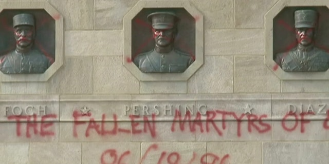 "Vandals spray-painted ""Glory to the fallen martyrs,"" on the World War I Memorial"
