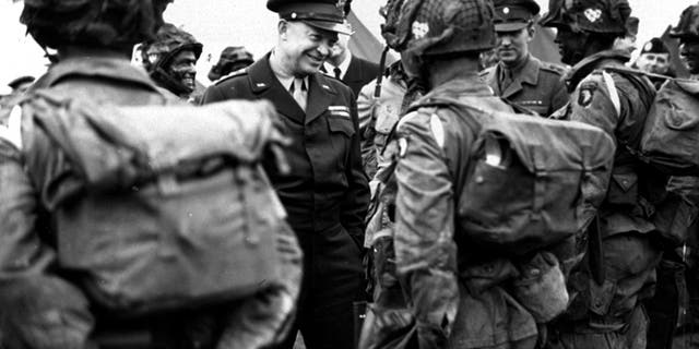 "June 6, 1944: General Dwight Eisenhower gives the order of the day, ""Full Victory - Nothing Else"" to paratroopers in England just before they board their planes to participate in the first assault in the invasion of the continent of Europe. June 6, 2019, marks the 75th anniversary of D-Day, the assault that began the liberation of France and Europe from German occupation, leading to the end World War II. (U.S. Army Signal Corps Photo via AP)"