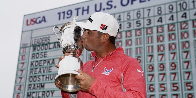 Gary Woodland poses with the trophy after winning the U.S. Open Championship golf tournament June 16, 2019, in Pebble Beach, Calif. (Associated Press)