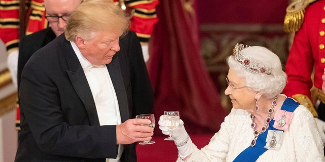 President Trump and Queen Elizabeth II share a toast during the State Banquet at Buckingham Palace, in London, Monday, June 3, 2019. Trump is on a three-day state visit to Britain.