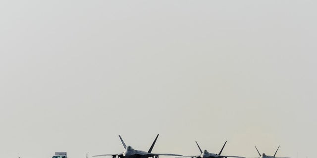 Air Force F-22 Raptors arrive at Al Udeid Air Base, Qatar, on June 27 to defend American forces and interests in U.S. Central Command.