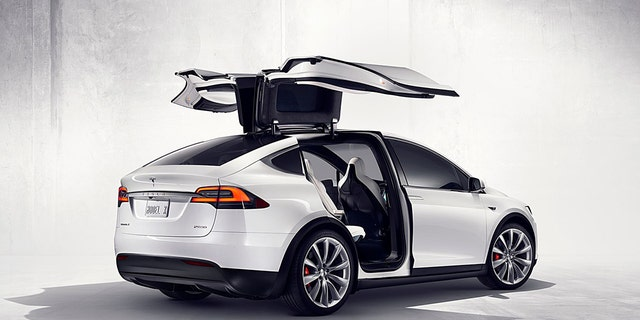 "The Model X features unique ""Falcon Wing"" rear doors."