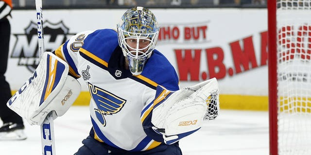 St. Louis Blues goaltender Jordan Binnington throwing a puck to make a save opposite a Boston Bruins during a second duration in Game 7 of a NHL's Stanley Cup Final on Wednesday in Boston. (AP Photo/Michael Dwyer)