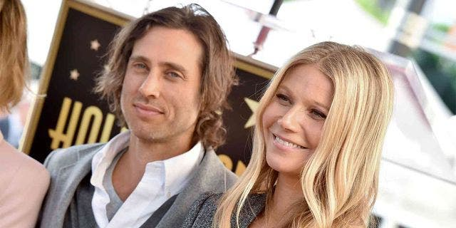Actress Charlize Theron referenced Gwyneth Paltrow, right, and husband Brad Falchuk's past arrangement of living in separate homes as an approach she would take in her next relationship.
