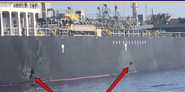 This June 13, 2019, image released by the U.S. military's Central Command, shows damage and a suspected mine on the Kokuka Courageous in the Gulf of Oman near the coast of Iran. The U.S. military on Friday, June 14, 2019, released a video it said showed Iran's Revolutionary Guard removing an unexploded limpet mine from one of the oil tankers targeted near the Strait of Hormuz, suggesting the Islamic Republic sought to remove evidence of its involvement from the scene.