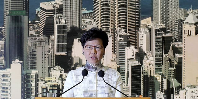 Hong Kong's Chief Executive Carrie Lam arrives holds a press conference in Hong Kong on Saturday, June 15, 2019. Lam said she will suspend a proposed extradition bill indefinitely in response to widespread public unhappiness over the measure, which would enable authorities to send some suspects to stand trial in mainland courts.
