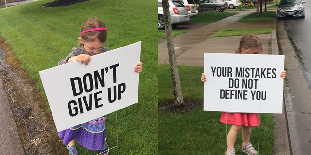 The founder's young daughters, pictured, have helped set up the famous signs.