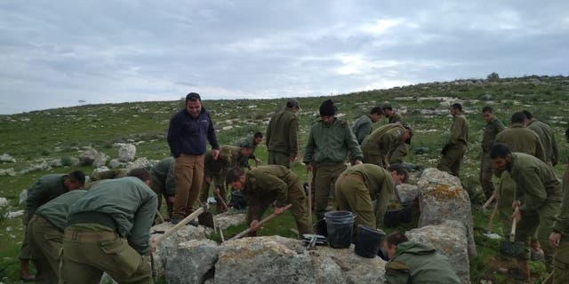 Israeli soldiers taking part in the excavation of the ancient watchtower.
