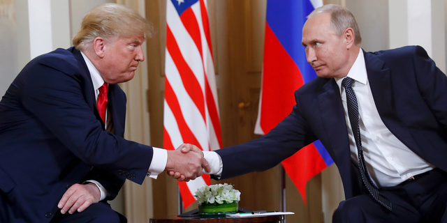 In this July 16, 2018, file photo, U.S. President Donald Trump, left, and Russian President Vladimir Putin shake hands at the beginning of a meeting at the Presidential Palace in Helsinki, Finland. (AP Photo/Pablo Martinez Monsivais)
