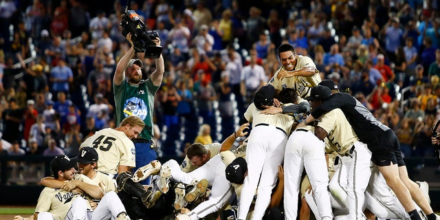 Vanderbilt players celebrate after defeating Michigan in Game 3 of the NCAA College World Series baseball finals in Omaha, Neb., Wednesday, June 26, 2019. (Associated Press)