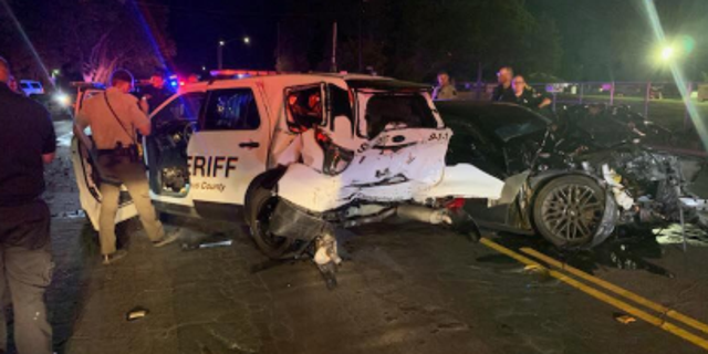 A suspected drunk driver rear-ended a patrol car early Saturday with two deputies inside.