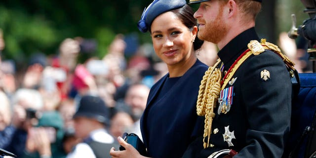 FILE: British Meghan, Duchess Sussex, and Prince Harry ride in a coach to attend the annual Trooping the Color ceremony in London, Saturday, June 8, 2019.