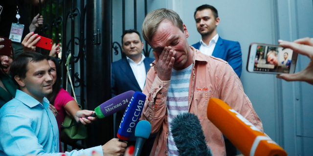 Prominent Russian investigative journalist Ivan Golunov, cries as he leaves a Investigative Committee building in Moscow, Russia, Tuesday, June 11, 2019. In a surprising turnaround, Russia's police chief on Tuesday dropped all charges against a prominent investigative reporter whose detention sparked public outrage and promised to go after the police officers who tried to frame the journalist as a drug-dealer.