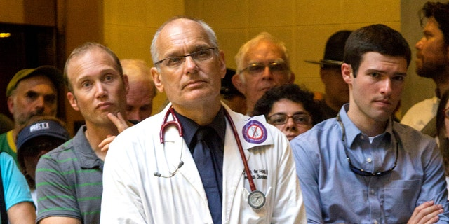 Dr. Charles van der Horst, center, was confirmed dead Saturday after crossing the Hudson River in New York as part of a seven-step marathon, organizers announced the race.