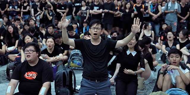 Protesters sing after a march against an extradition bill outside Legislative Council in Hong Kong on Sunday, June 16. (AP)
