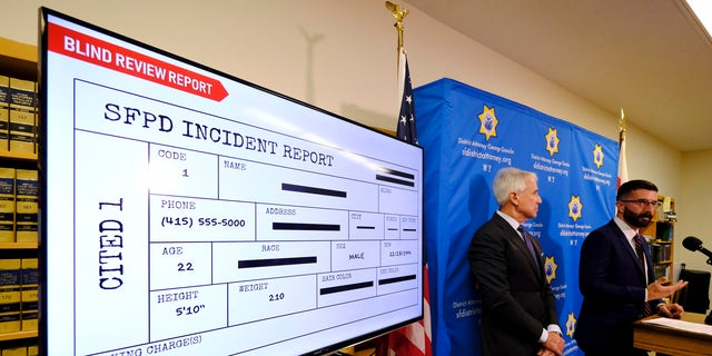 With a blind police incident report displayed, San Francisco District Attorney George Gascon, left, and Alex Chohlas-Wood, Deputy Director, Stanford Computational Policy Lab, talk about the implementation of an artificial intelligence tool to remove potential for bias in charging decisions, on June 12, 2019, in San Francisco. (AP Photo/Eric Risberg)