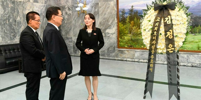 In this photo provided by South Korea Unification Ministry, North Korean leader Kim Jong Un's sister, Kim Yo Jong, speaks to South Korean presidential national security director Chung Eui-yong, second from left, and a lawmaker Park Ji-won, left, near the condolence flowers for former South Korean first lady Lee Hee-ho at the northern side of the border village of Panmunjom in the Demilitarized Zone, South Korea, Wednesday, June 12, 2019.