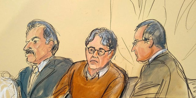 FILE - In this Tuesday, May 7, 2019 file courtroom drawing, defendant Keith Raniere, center, leader of the secretive group NXIVM, is seated between his attorneys during the first day of his sex trafficking trial.