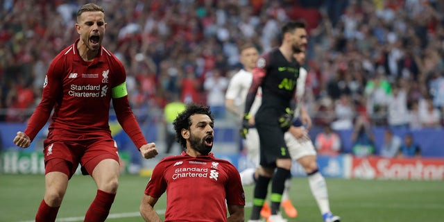 Liverpool's Mohamed Salah, bottom, celebrates after scoring his side's opening goal during the Champions League final soccer match between Tottenham Hotspur and Liverpool at the Wanda Metropolitano Stadium in Madrid, Saturday. (Associated Press)