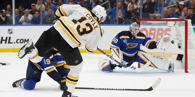 Boston Bruins center Charlie Coyle (13) scores a goal against St. Louis Blues goaltender Jordan Binnington (50) during the first period of Game 3 of the NHL hockey Stanley Cup Final on Saturday in St. Louis. (Associated Press)