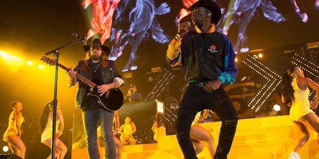Billy Ray Cyrus, left, and Lil Nas X perform at HOT 97 Summer Jam 2019 at MetLife Stadium on Sunday, June 2, 2019, in East Rutherford, N.J. (Associated Press)