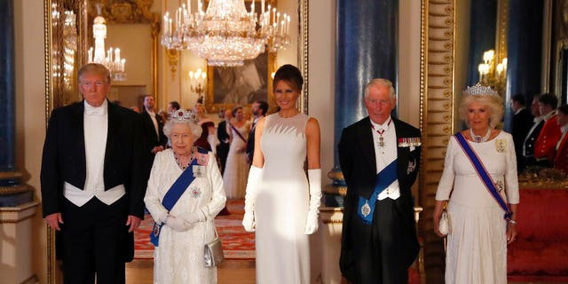 From left, US President Donald Trump, Britain's Queen Elizabeth II, first lady Melania Trump, Prince Charles and Camilla, the Duchess of Cornwall pose for the media ahead of the State Banquet at Buckingham Palace in London.
