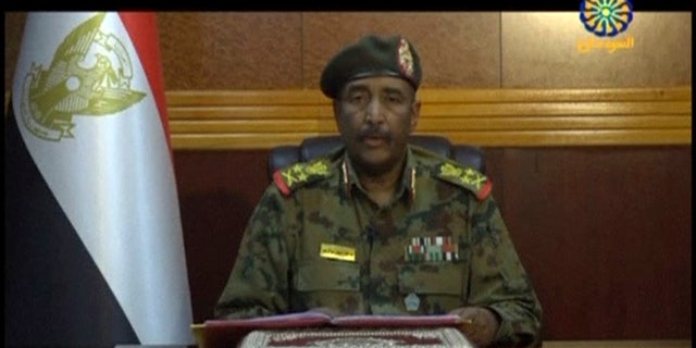 In this frame grab from video provided by Sudan TV, Lieutenant General Abdel-Fattah Burhan, head of the Sudanese Transitional Military Council, TMC, makes a broadcast announcement in Khartoum, Sudan, Tuesday, June 4, 2029. (Sudan TV via AP)