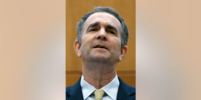 Virginia Governor Ralph Northam makes remarks at a press conference dealing with gun violence in the state, inside the Patrick Henry Building in Richmond, Va., Tuesday, June 4, 2019. (Bob Brown/Richmond Times-Dispatch via AP)