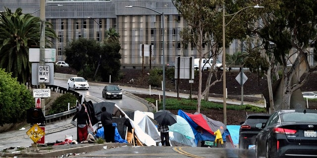 A homeless encampment along a downtown Los Angeles street near a freeway in January 2019. (AP Photo/Richard Vogel, File)