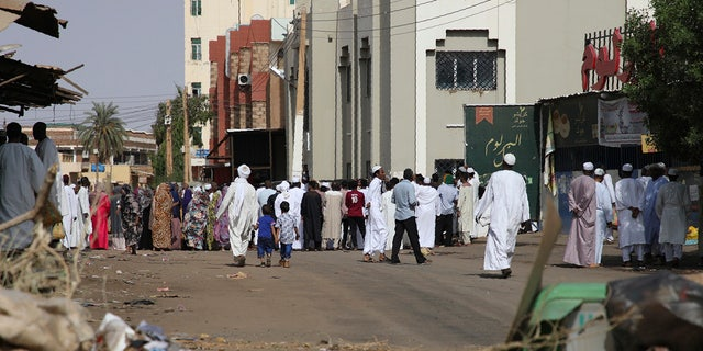 Worshippers gather at a mosque behind a roadblock set by protesters on a main street in the Sudanese capital Khartoum to stop military vehicles from driving through the area on Wednesday, June 5, 2019. (AP Photo)