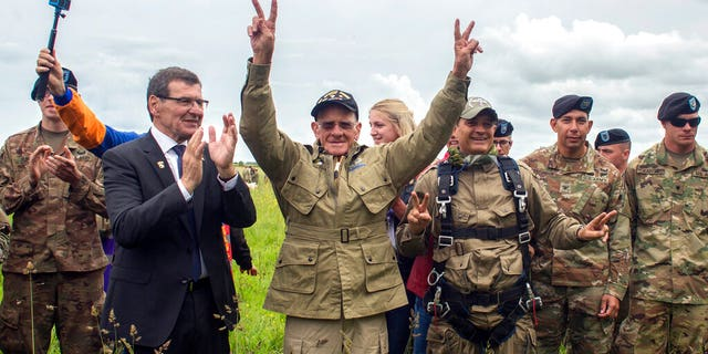 U.S. World War II D-Day veteran Tom Rice, from Coronado, CA, after parachuting in a tandem jump into a field in Carentan, Normandy, France, Wednesday, June 5, 2019.
