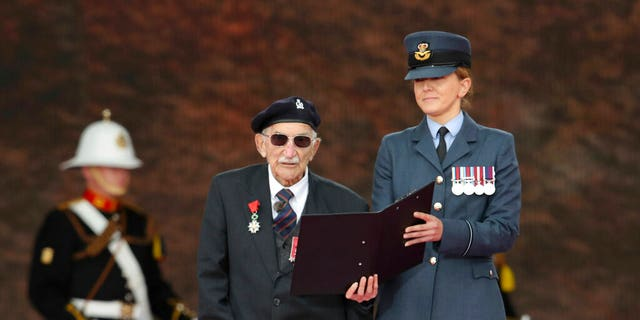 D-Day veteran John Jenkins on stage during commemorations for the 75th Anniversary of the D-Day landings, in Portsmouth, England, Wednesday June 5, 2019.