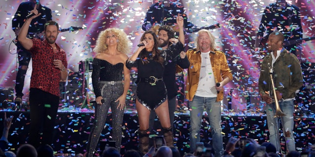 "Little Big Town, Thomas Rhett and Trombone Shorty perform ""Don't Threaten Me With A Good Time"" at the CMT Music Awards on Wednesday."