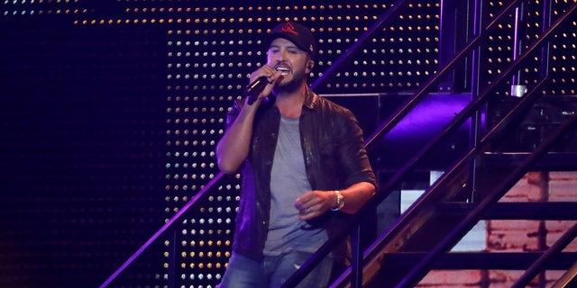 "Luke Bryan performs ""Knockin' Boots"" at the CMT Music Awards on Wednesday, June 5, 2019, at the Bridgestone Arena in Nashville, Tenn."