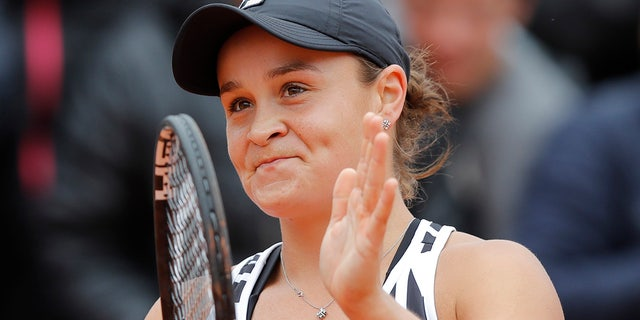 Australia's Ashleigh Barty celebrates winning her semifinal match of the French Open tennis tournament against Amanda Anisimova of the U.S. in three sets 7-6 (7-4), 6-3, 6-3, at the Roland Garros stadium in Paris, Friday, June 7, 2019. (AP Photo/Michel Euler)