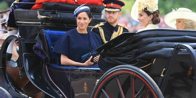 Britain's Prince Harry, Meghan Duchess of Sussex, Kate Duchess of Cambridge and Camilla Duchess of Cornwall attend the annual Trooping the Colour Ceremony in London, Saturday, June 8, 2019. (Gareth Fuller/PA via AP)