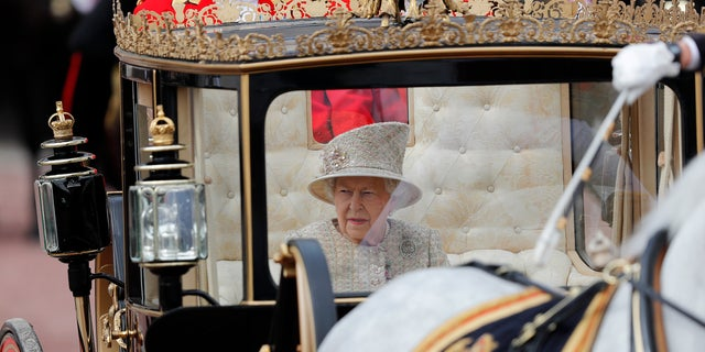 British Queen Elizabeth rides in a carriage to attend the annual Trooping the Color ceremony in London on June 8, 2019.