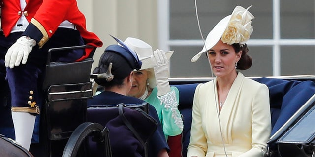 The British Camilla, the Duchess of Cornwall left Kate, the Duchess of Cambridge and Meghan, the Duchess of Sussex with a coach to the annual Trooping the Color Ceremony