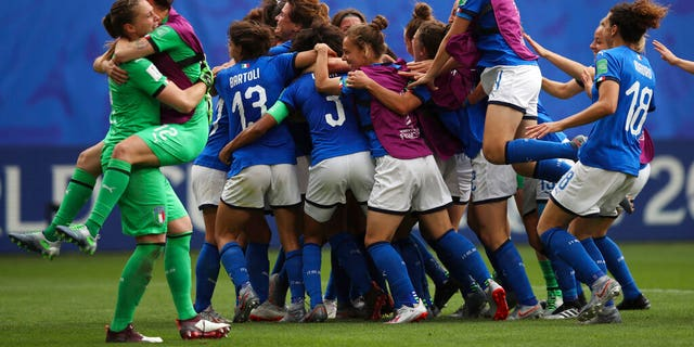 Players of Italy celebrate after winning the Women's World Cup Group C soccer match between Australia and Italy at the Stade du Hainaut in Valenciennes, Sunday, June 9, 2019.