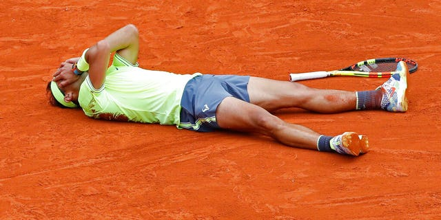 Spain's Rafael Nadal celebrates his record 12th French Open tennis tournament title after winning his men's final match against Austria's Dominic Thiem in four sets at the Roland Garros stadium in Paris on Sunday.