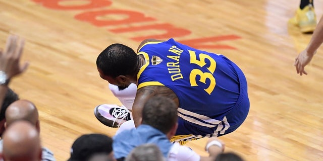 Golden State Warriors brazen Kevin Durant (35) goes down with a leg damage opposite a Toronto Raptors during initial half movement in Game 5 of a NBA Finals in Toronto on Monday, Jun 10, 2019. (Frank Gunn/The Canadian Press around AP)