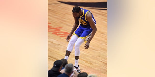 Golden State Warriors forward Kevin Durant (35) hobbles after injuring his right leg during first-half basketball action in Game 5 of the NBA Finals against the Toronto Raptors in Toronto, Monday, June 10, 2019. (Frank Gunn/The Canadian Press via AP)