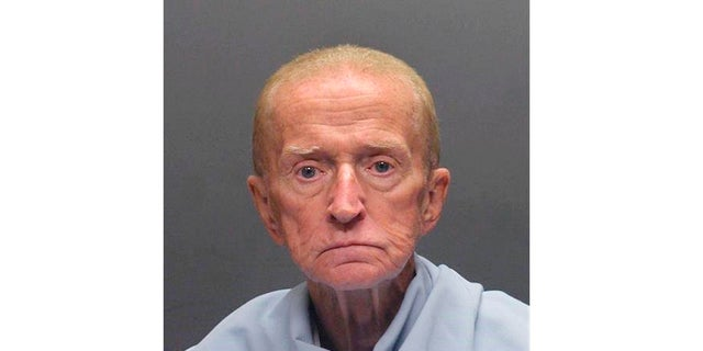 This file photo released on Jan. 14, 2018, by the Tucson Police Department shows Robert Francis Krebs, who has a decades-long criminal record for stealing from banks. The 81-year-old is charged with robbing a credit union in Tucson in January 2018. Attorneys in his latest criminal case are arguing about whether Krebs is mentally competent to stand trial. (Tucson Police Department via AP, File)