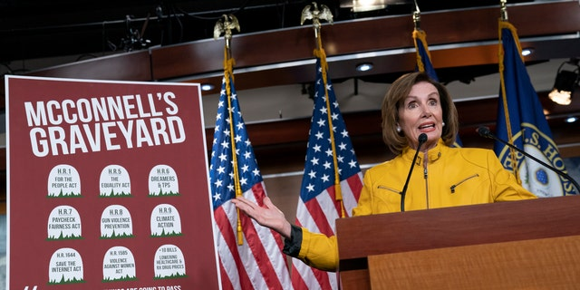 Speaker of the House Nancy Pelosi, D-Calif., reflects on bills that have passed the House but die in the Senate because Senate Majority Leader Mitch McConnell, R-Ky., does not bring them up for a vote, during a news conference on Capitol Hill. (AP Photo/J. Scott Applewhite)