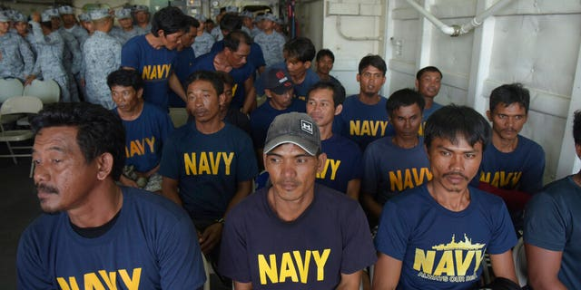 Rescued Filipino fishermen sit inside Philippine Navy ship BRP Ramon Alcuaz as they head back to shore at Occidental Mindoro province, Philippines on Friday June 14, 2019. The Philippines' top diplomat said he has filed a diplomatic protest after an anchored fishing boat was hit by a suspected Chinese vessel which then abandoned the 22 Filipino fishermen as the boat sank in the disputed South China Sea.