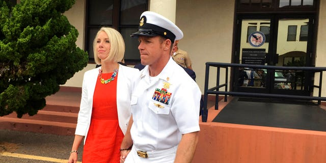FILE: Navy Special Operations Chief Edward Gallagher leaves a military courtroom on Naval Base San Diego with his wife, Andrea Gallagher, in San Diego.