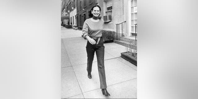 Undated file photo heiress and designer Gloria Vanderbilt walks down a New York street. (New York Post via AP, File)